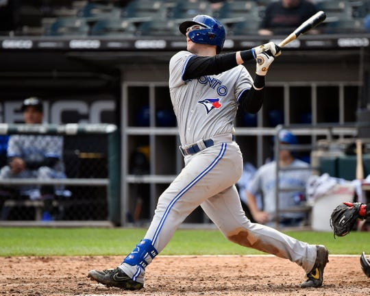 Toronto Blue Jays catcher Danny Jansen watches the flight of his home run against the White Sox.