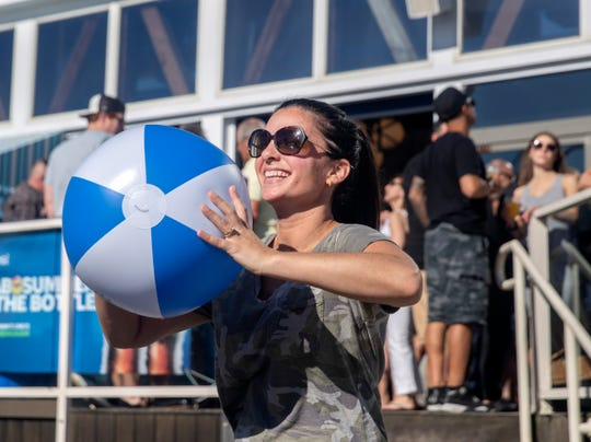 Jennifer Glaydura of New Providence, NJ, tosses around a beach ball.The Jenkinson's summer kickoff in Point Pleasant Beach on May 24, 2019, featured performances by Walk the Moon, Mabel, Lizzo and Fletcher.