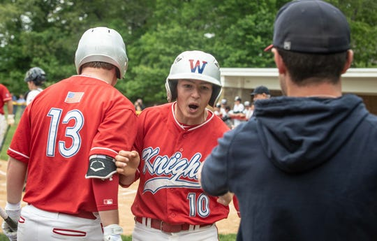 Wall's Johnny Volpe (No. 10) is congratulated by teammate Jay Bant (No. 13) after he scored the Crimson Knights' first run on Teddy Sharkey's double in the first inning of Wall's 3-1 win over Colts Neck Thursday in a NJSIAA Central Group III semifinal.
