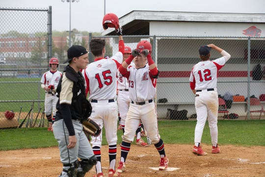 Jackson Liberty senior catcher David Melfi (Center, No. 13), shown after he scored a run in a game against Point Pleasant Boro earlier this month, homered to lead off the bottom of the seventh Friday to give Jackson Liberty a 5-4 win over Allentown in a NJSIAA South Group III quarterfinal.