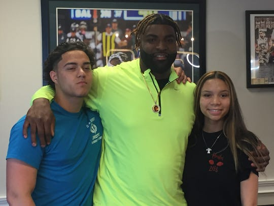 Vinny Curry with Neptune students Frederick Reyes-DeLeon and Angel Blue