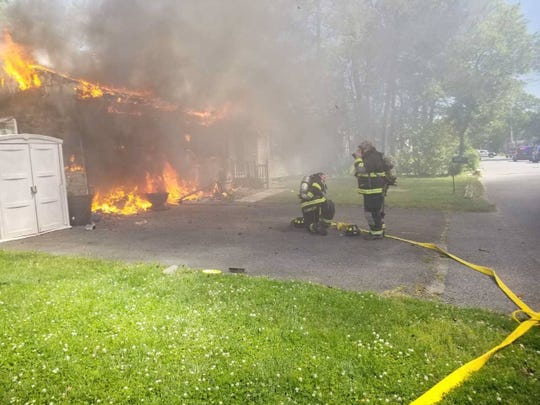 Fire crews at the scene of a house fire on Spar Avenue in Beachwood May 21.