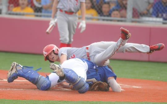 Albany's B.J. Morris collides with Hale Center catcher Esai Flores on a play at the plate during the first inning of Game 1 of a Region I-2A semifinal baseball series Thursday, May 23, 2019, at Hermleigh Cardinal Field.