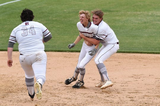 Hawley's Tate Thompson (33) grabs Jaron Reynolds (3) in celebration after the 4-3 walk-off win against New Deal in Game 1 of the Region I-2A semifinal series Fridayat Hardin-Simmons' Hunter Field.