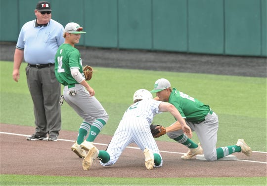 Wall pitcher Caleb Heuertz, right, tags out Breckenridge's Owen Woodward, who was caught in a rundown on a pickoff play in the second inning after  reaching on a leadoff single. Wall beat the Buckaroos 5-4 in the opener of the Region I-3A semifinal series Friday, May 24, 2019, at ACU's Crutcher Scott Field.