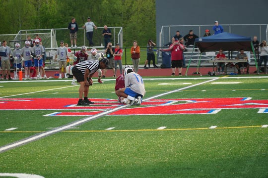 Owego's Jo Race (17) and Johnson City's Cade Dino position themsleves for a face-off during Thursday's Section 4 Class C final at Owego. Race won 19 of 25 faceoffs to help the Indians to a 14-11 victory.