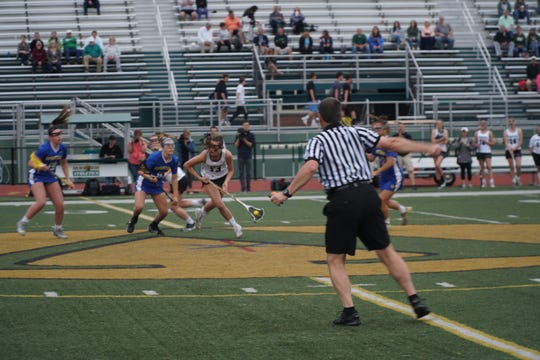 Vestal senior Sarah Harding scoops a groundball following a draw during the Golden Bears' 14-5 victory over visiting Maine-Endwell in the Section 4 Class C final at Dick Hoover Stadium.