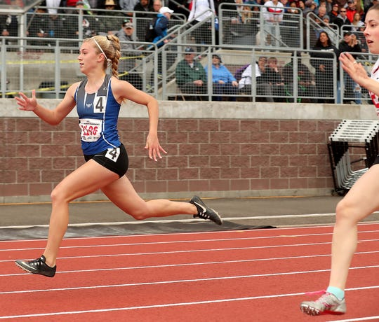 Olympic's Hanna Troy runs in a preliminary race in the 100-meter dash on Friday at the state track and field championships at Mount Tahoma High School.