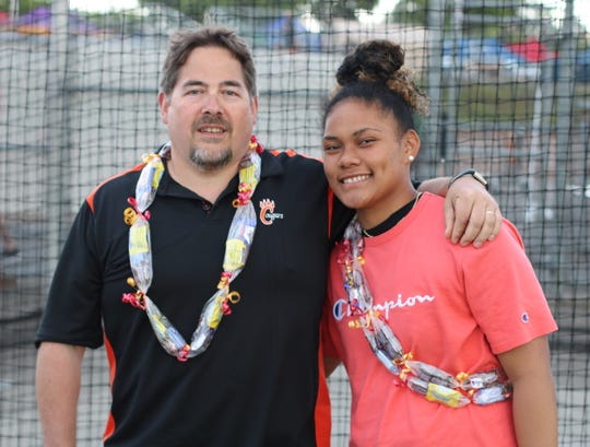 Central Kitsap's Pono Fuiava and throws coach Bill Braun are all smiles after Fuiava won the girls Class 3A state discus title Thursday at Mount Tahoma High School.