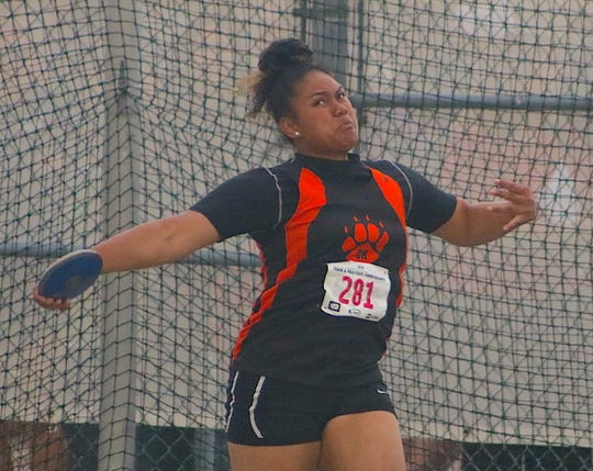 Central Kitsap's Pono Fuiava won the girls Class 3A state discus title Thursday at Mount Tahoma High School. Her winning throw of 146 feet, 1 inch set a new West Sound track and field record.