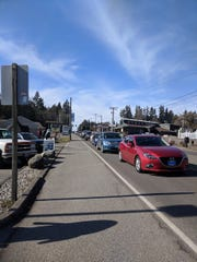 A traffic backup in Kingston lines up in front of Tania Issa's Kingston Mercantile and Marine store as vehicles wait to board a state ferry bound for Edmonds.