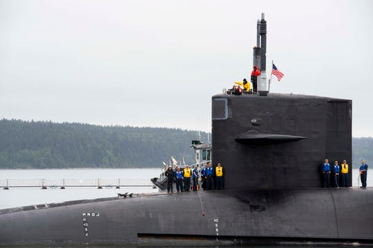 The guided-missile submarine USS Michigan (SSGN 727) arrives at Naval Magazine Indian Island earlier this month after being forward-deployed for 30-months. It is headed for work at Puget Sound Naval Shipyard.