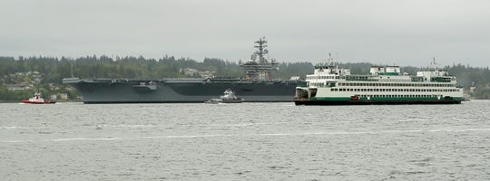 The USS Nimitz and the M/V Kaleetan pass Bachmann Park in Manette on Friday.