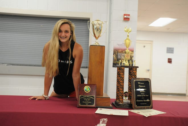 Chesney Gardner adds to the extensive collection of hardware she's accumulated during her career at Owen on May 21 when she earned several trophies, including her second straight Athlete of the Year award for the school.