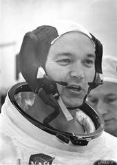 In his space suit, Command Module (CM) pilot Michael Collins does a final check of his communications system before the boarding of the Apollo 11 mission.