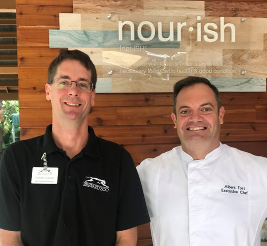 Service Systems Associates general manager Thomas Yeatman, left, and executive chef Albert Fort have brought a new concept in dining to the Brevard Zoo.