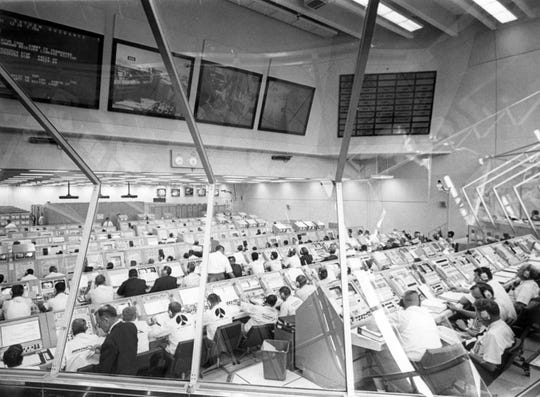 Every console was manned in firing room 1 of the Kennedy Space Flight Center (KSC) control center during the launch countdown for Apollo 11.