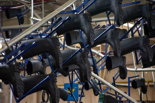 Rubber boots cool at the Genfoot America factory in Littleton, New Hampshire, on May 20, 2019