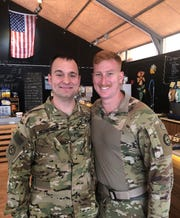 Dan McEnerney, left, and Matt Schnepp pose for a photo while reunited for a day during their recent deployment in the Middle East with the Vermont Army National Guard. The duo will be running a Vermont City Marathon relay on Sunday, May 26, 2019.