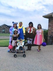 The McLaughlin family stands together on Halloween 2018.