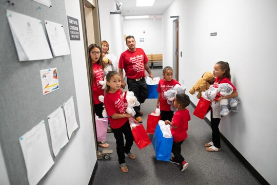 Armando Cantu walks out of the Aransas County Court at Law office with the seven children he adopted with his wife, Naomi Rodriguez, on Friday, May 24, 2019. Six of the seven children Naomi and Armando adopted were siblings.