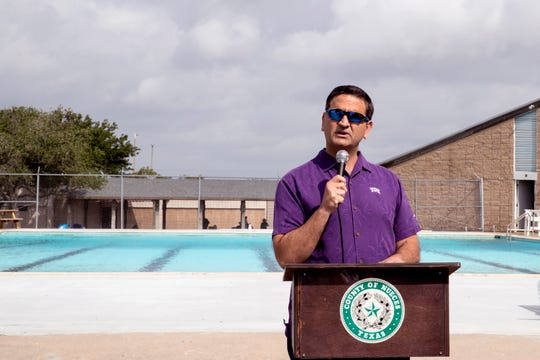 Nueces County Commissioner Brent Chesney speaks at the Re-Grand Opening of Parker Pool in Flour Bluff on Friday, May 24, 2019. Using funds made available by Chesney, the Nueces County Inland Parks Department and the Coastal Bend Friends of Aquatics made extensive renovations and enhancements to the pool.