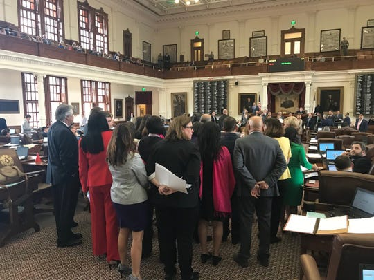 Members of the Texas House wait for a bill to be debated during the 2019 session of the Legislature.