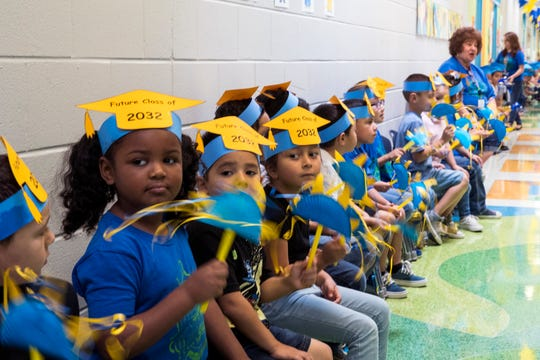 Students from Garcia Elementary School wait for Moody High School graduates to arrive for the fifth annual Trojan Senior Walk at Garcia Elementary on Friday, May 24, 2019.
