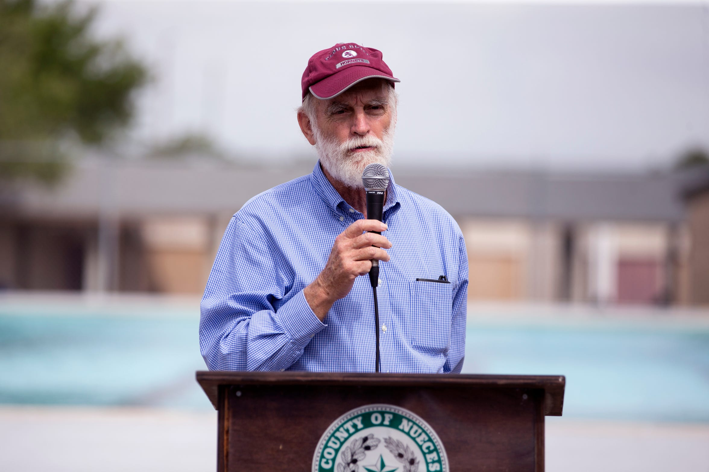 City Council Member Greg Smith speaks about the history of Parker Pool during the Re-Grand Opening of the pool in Flour Bluff on Friday, May 24, 2019. The Nueces County Inland Parks Department and the Coastal Bend Friends of Aquatics made extensive renovations and enhancements to the pool.