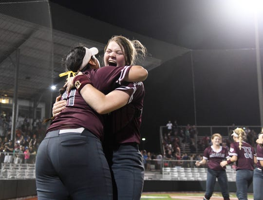 Calallen players celebrate after defeating Flour Bluff in Game 2 of a regional final series to qualify for the Class 5A state tournament. The Wildcats won 5-4 at Cabaniss Softball Field on Thursday, May 23, 2019.