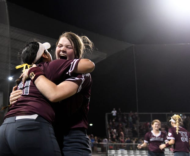 Calallen's Aviana Gonzalez, left, and Aly Wiggins celebrate the team's win against Flour Bluff in their second game in the Class 5A regional final series, Thursday, May 23, 2019, at Cabaniss Softball Field. Calallen will advance to state after winning, 5-4.