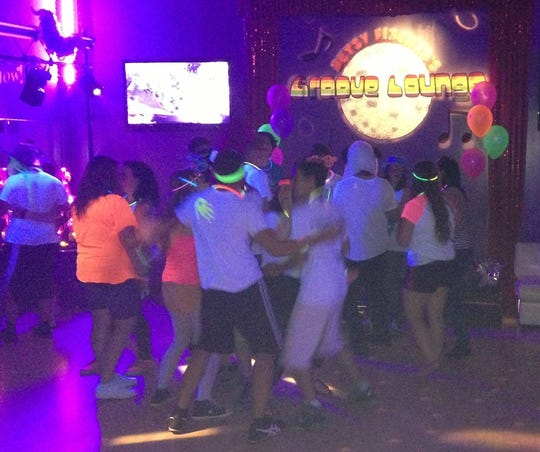 Guests dances at a party at Betsy Fischer's Groove Lounge. The Voorhees venue is booking parties until the end of June, when it will close.
