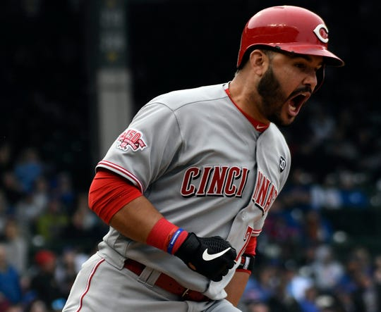 Cincinnati Reds third baseman Eugenio Suárez reacts after hitting a two-run home run against the Chicago Cubs in the ninth inning at Wrigley Field on Friday, May 24, 2019.