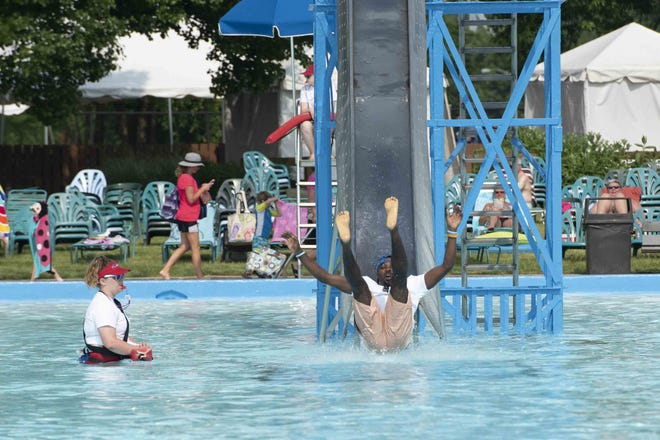 Local celebrities participated in the Cannonball Splash for Charity at Coney Island to raise money for the Dragonfly Foundation.  Omar Cummings FC Cincinnati Club Ambassador.