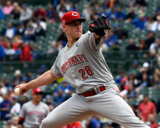 Cincinnati Reds starting pitcher Anthony DeSclafani throws the ball against the Chicago Cubs in the first inning at Wrigley Field on Friday, May 24, 2019.