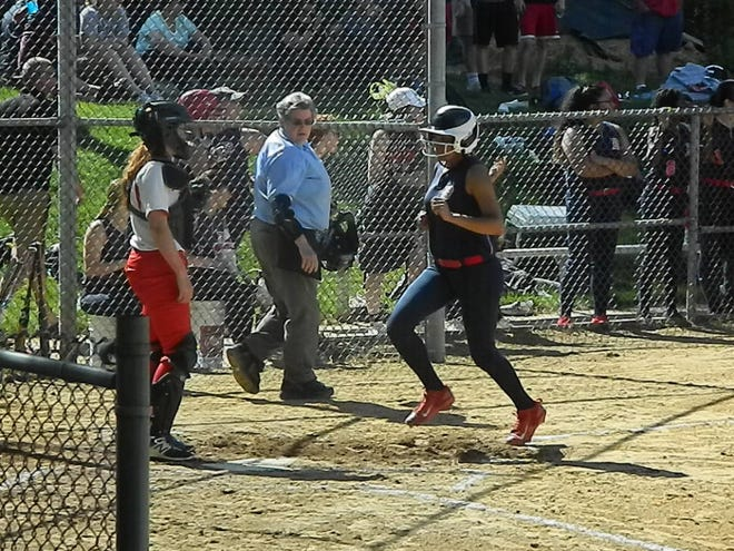 Dunellen's Alexis Coore scores a run against Point Beach during the Central Group I semifinals on Friday, May 24, 2019.