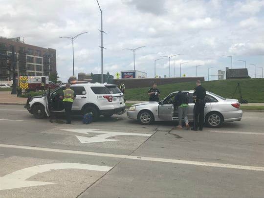 A sedan rear-ended a Des Moines police car early Friday afternoon just south of downtown. The officer and suspect inside the car sustained minor injuries.