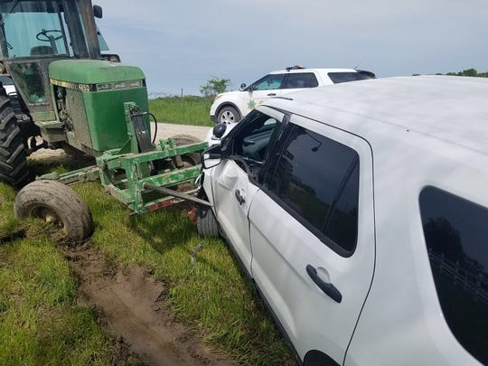 Authorities say an Iowa man used the bale spear on the end of a tractor to impale a sheriff's car and push it more than 100 feet on Thursday in southern Iowa.