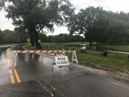 Des Moines closed George Flagg Parkway at Southwest 30th Street on Friday near the Raccoon River. Portions of land near the river saw minor flooding.