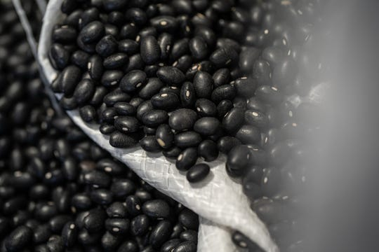 A bag of black beans are seen at Steve Findlay Farms, LLC in Reese on Monday, May 20, 2019. Findlay, a third-generation farmer, grows black beans that are sold to Mexico amongst his other crops which consist of sugar beets, navy beans, soybeans, wheat and corn.