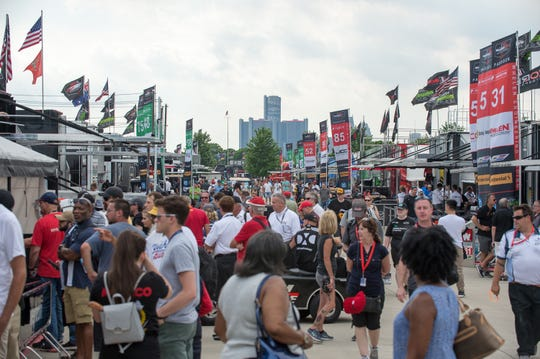 Detroit Grand Prix race fans will enjoy getting up close to the action in the winner's circle and paddock this year.