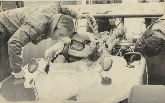 Defending Indy 500 champion Mark Donohue of Newton Square, Pa., talks to car owner Roger Penske during fuel tests at the Indianapolis Motor Speed way during the last runnings of the cars in 1973.