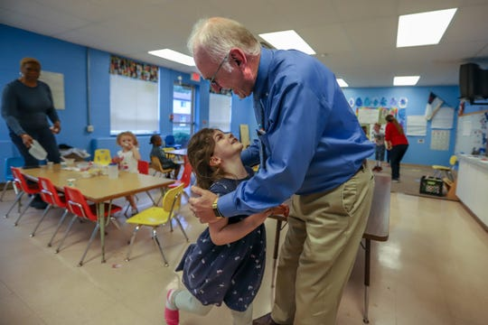 Pastor Mark Hetzner, 66, of Chesterfield Twp is greeted by preschooler Alexandra Callahan, 5, of Warren after having breakfast at St. Thomas Lutheran Church and School in Eastpointe, Mich. photographed on Thursday, May 23, 2019. The school reopened under the Michigan Great Start Readiness program.