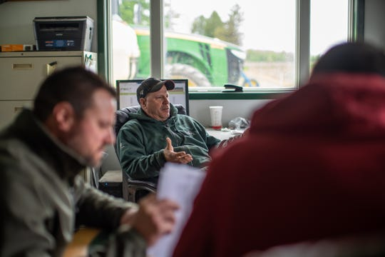 Steve Findlay, 53, owner of Steve Findlay Farms, LLC talks with others in his office at his farm in Reese on Monday, May 20, 2019. Findlay, a third-generation farmer, grows black beans that are sold to Mexico amongst his other crops which consist of sugar beets, navy beans, soybeans, wheat and corn.