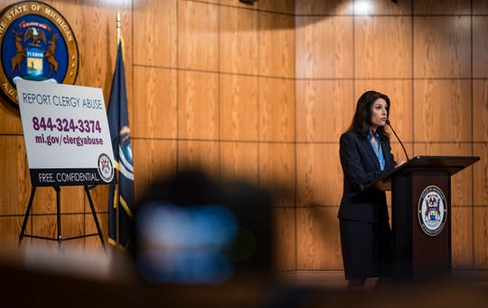 """This is just the tip of the iceberg,"" Michigan Attorney General Dana Nessel says Friday. May 24, 2019, during a news conference in Lansing, Mich. Law enforcement with the Michigan Attorney General's office on Thursday charged five men with 21 counts of criminal sexual conduct as part of its ongoing investigation into sex abuse at Catholic churches in the state. The charges are based on disturbing evidence of abuse investigators said they found in records seized from Michigan dioceses, authorities said Friday, and just the first in what will be a long investigation of clergy abuse in Michigan."