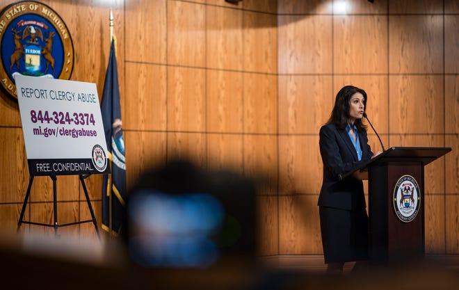 """""""This is just the tip of the iceberg,"""" Michigan Attorney General Dana Nessel says Friday. May 24, 2019, during a news conference in Lansing, Mich. Law enforcement with the Michigan Attorney General's office on Thursday charged five men with 21 counts of criminal sexual conduct as part of its ongoing investigation into sex abuse at Catholic churches in the state. The charges are based on disturbing evidence of abuse investigators said they found in records seized from Michigan dioceses, authorities said Friday, and just the first in what will be a long investigation of clergy abuse in Michigan."""