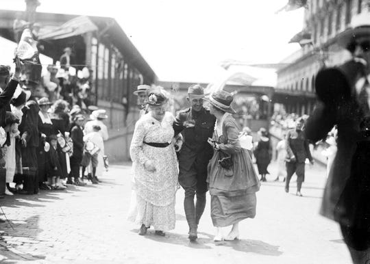 A returning soldier from the 339th Infantry is reunited with loved ones on July 3, 1919, at Michigan Central Depot in Detroit. Many of the Polar Bears never made it home.