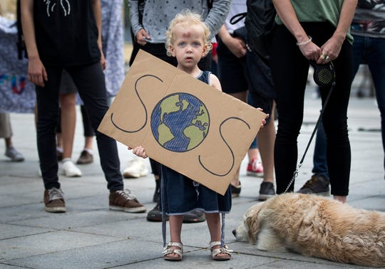 A young protestor takes part in a demonstration organized by 'Global Strike 4 Climate' in Vilnius, Lithuania, Friday, May 24, 2019.