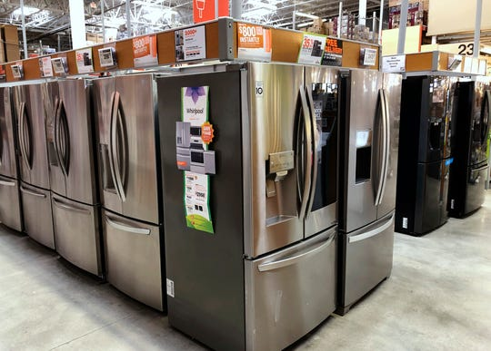 Refrigerators are shown for sale at a Home Depot store in Miami Lakes, Fla.