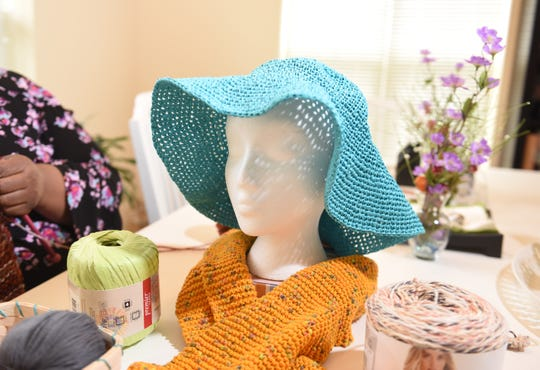 A crocheted sun hat and knitted scarf by Gregg Burrell of Highland Park at her Highland Park studio.